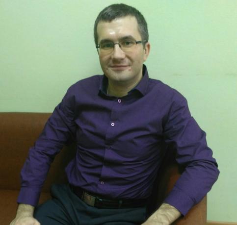 Роман Кузьминов